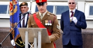 Coury 18 Colourr Sergeant Bill Johnson reads the VC cittation'