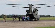 Civilian Instructors Exiting a Chinook