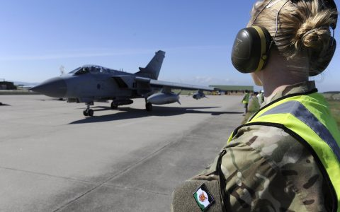 A Royal Air Force groundcrew member watches as a Tornado GR4 aircraft taxis for takeoff at RAF Lossiemouth in Scotland.   12(B) Sqn war week was a collective training event 10th-14th June 2013 designed to expose all squadron personnel to the tempo of operations and to the potential situations that they might encounter during their forthcoming deployment on Operation Herrick.12(B) Sqn is home to the Tornado GR4 Aircraft.