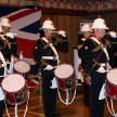 The Royal Marines Band Scotland Corp of Drums performs for guests.