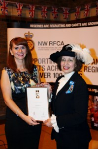 Abila Pointing, High Sheriff of Merseyside, presents the Employer Recognition Scheme Silver Award to Zoe Sinclair, Eddie Stobart.